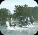 Crow girls on horses crossing river in Wyoming